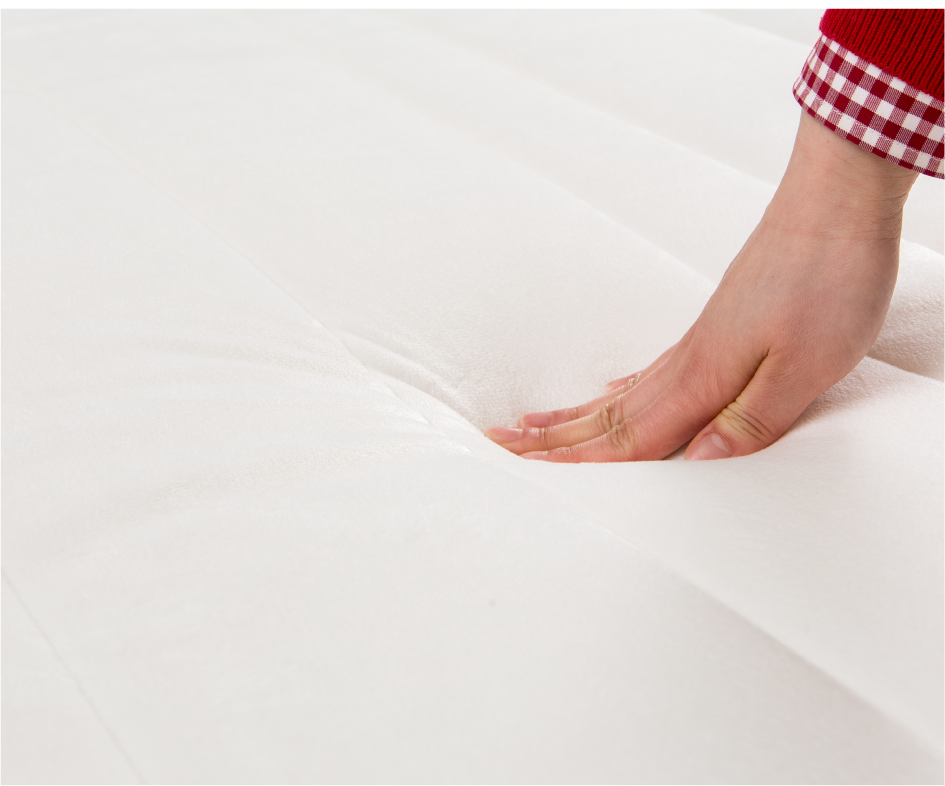customers hand touching a mattress from best mattress